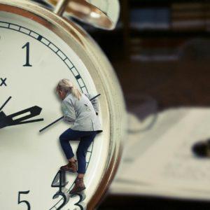 person climbing up clock